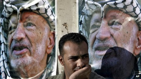 A Palestinian weeps following the death of Yasser Arafat (11 November 2004)