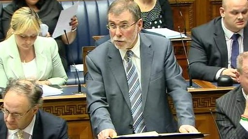 The Northern Ireland Housing Executive (NIHE) is failing its tenants and taxpayers, Social Development Minister Nelson McCausland told the assembly.