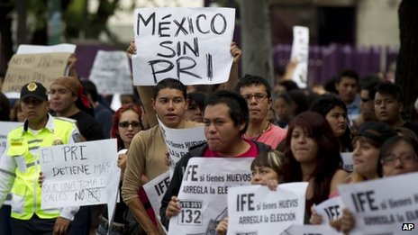 Demonstrators protest outside an office of the Federal Electoral Institute in Mexico City July 3, 2012