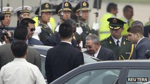 Cuba&#039;s Raul Castro walks towards a car upon his arrival for his four-day visit to China, at the Beijing international airport 4 July, 2012