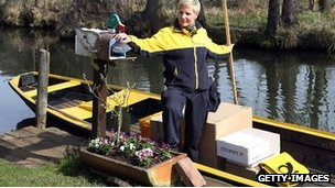 Deutsche post employee delivers mail by boat in Spreewald