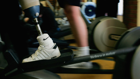 An injured solder with a prosthetic leg uses the gym at Headley Court
