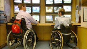 Two disabled employees at work