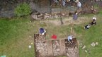 Volunteers digging on the banks of the River Coquet