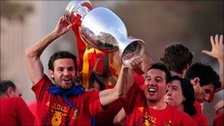 Juan Mata (left) and Santi Cazorla of Spain holds the UEFA EURO 2012 trophy aloft 