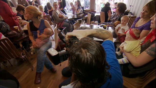 Breast-feeding mothers gather at a cafe in Bristol to protest against the way another mother was treated