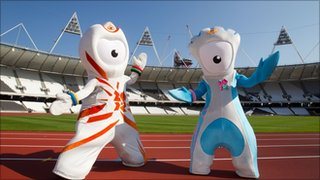 Wenlock and Mandeville stand on the running track of the Olympic Stadium