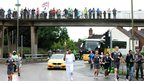 Sibtain Damji carries the torch in Peterborough, 4 July 2012