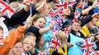 School children wave flags in Long Sutton, 4 July 2012