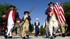 Members of the Freedom chapter of the Sons of the American Revolution march with the flag in a July 4th parade in The Woodlands, Texas 4 July 2012