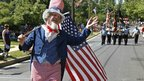 A man dressed as Uncle Sam takes part in the Independence Day parade in Tacoma Park, Maryland 4 July 2012