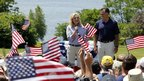 Ann and Mitt Romney speak to supporters after participating in the July 4th parade in Wolfeboro, New Hampshire 4 July 2012