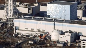 An aerial view shows the quake-damaged Fukushima nuclear power plant in the Japanese town of Futaba, Fukushima prefecture on 12 March, 2011