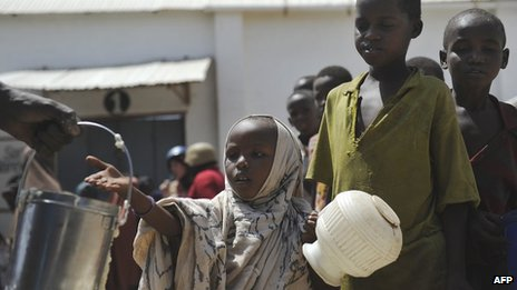 Displaced children queue for food rations in Somalia&#039;s capital, Mogadishu, in January 2012