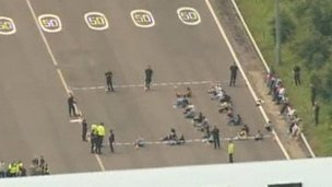 Passengers surrounded by officers on the M6 Toll motorway