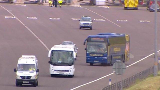 Megabus coach and police escort