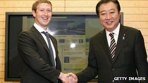 Mark Zuckerberg shakes hands with Yoshihiko Noda