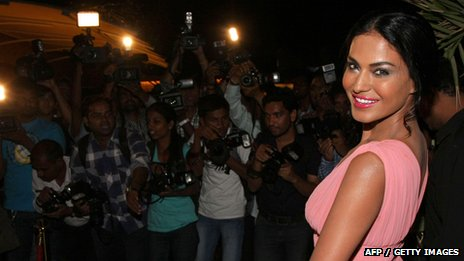 Veena Malik poses in front of photographers in 2012