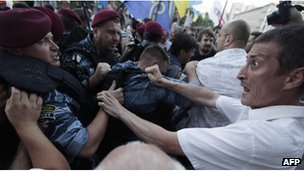 Riot police block opposition supporters on July 3, 2012 during a rally against a controversial Russian language bill in Kiev