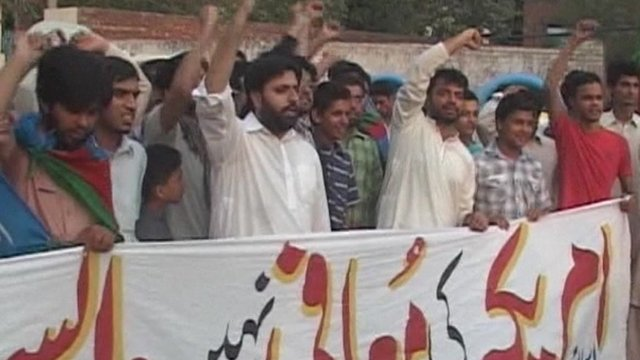 People in Pakistan protesting over the reopening of the NATO supply route to Afghanistan