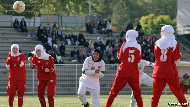 Muslim women playing football