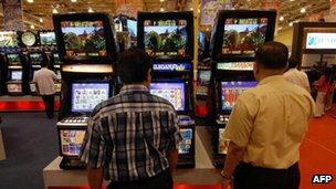 Visitors try out the latest gambling machines on display during a two-day trade exhibit on the gaming industry in Manila, 22 March 2007