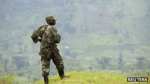 A Congolese government soldier stands guard at a military outpost between Kachiru village and Mbuzi hill, in eastern Democratic Republic of the Congo, May 25, 2012.