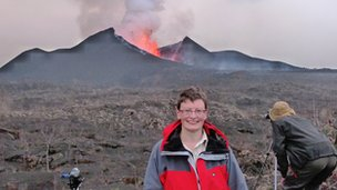 Dr Lorraine Field in front of the erupting Nyamuragira volcano