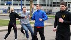 Men stage an attack during a training session for the Olympic Torch Security Team at the Metropolitan Police Training School on 9 March, 2012