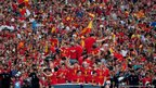 Spain's players parade the Euro 2012 trophy in Madrid