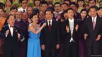 Chinese President Hu Jintao (centre) sings with outgoing Hong Kong Chief Executive Donald Tsang (left), upcoming Chief Executive-elect Leung Chun-ying (right), actress Liza Wang and singer Jacky Cheung