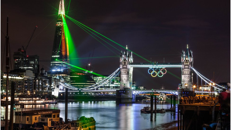The Shard's impressive laser show beams across London illuminating Tower  Bridge's giant Olympic rings. Photo