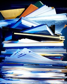 Stack of papers, envelopes, files and books