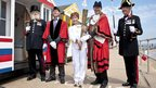 The Mayor of Southwold  Michael Ladd (second right) posed with torchbearer Caroline Emeny