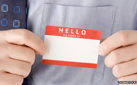 "Man putting on ""Hello - my name is"" sticker"