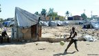 A young man playing with a ball in St Therese suburb of Port-au-Prince, Haiti