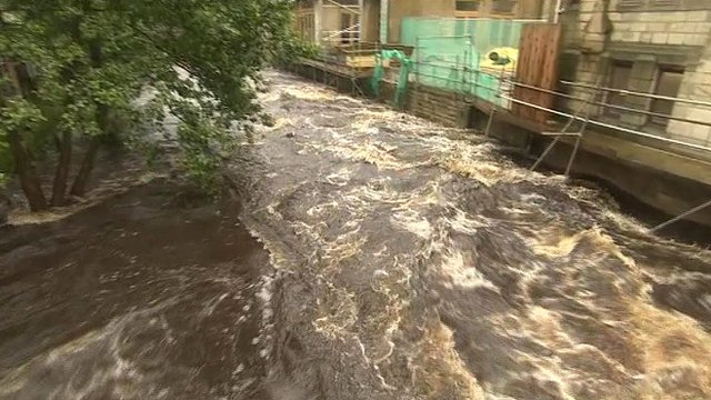 Hebden Water rushes through Hebden Bridge