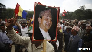 Supporter carries a poster of the former king in Kathmandu in June 2012