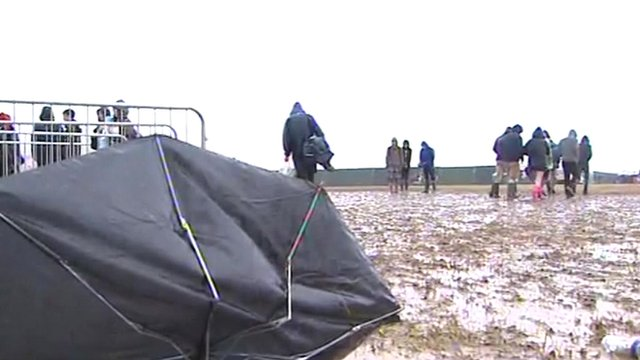Broken umbrella sits in the mud