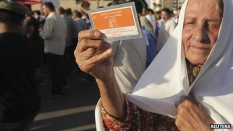 A woman holds up her election card during a demonstration in support of elections, in Benghazi  2 July 2012