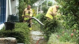 Fire crews pumping water out of homes