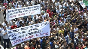 Anti-government protesters in Kafranbel, near the northern city of Idlib on 6 July 2012