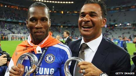 Ruud Gullit celebrates Chelsea's victory in the 2012 Champions League final with Didier Drogba