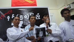 Burmese pro-democracy activists show picture of Phyo Phyo Aung, one of student leaders arrested in recent days - 7 July