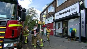 Firefighters outside John Hemingway Hair in Wallasey Village