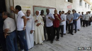 Voters queue at a polling station in Tripoli