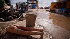 A part of destroyed mannequin by the flood is seen in mud in the Black Sea resort of Gelendzhik