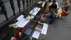People light candles in Moscow in memory of the flood victims. Photo: 7 July 2012