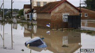 A submerged car in a flooded street in a village near Krymsk. Photo: 7 July 2012