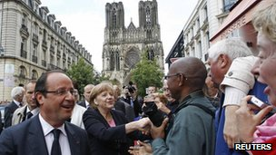 Francois Hollande and Angela Merkel meet the crowds in Reims. Photo: 8 July 2012
